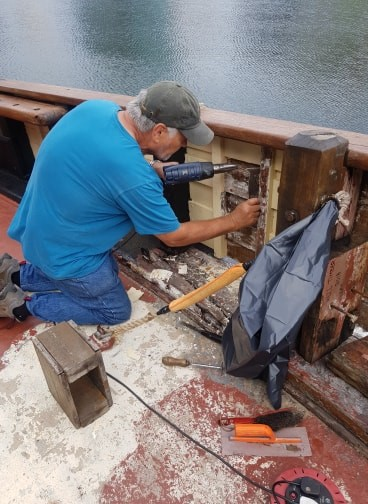 Picture 13 and 14: Continuing with conservation, Volunteers working on foredeck of Zebu