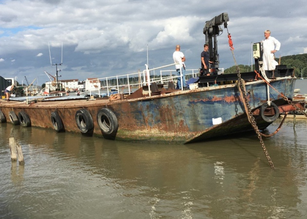 The 'Lasher' barge docking in at Woodbridge, after travelling down from the River Thames