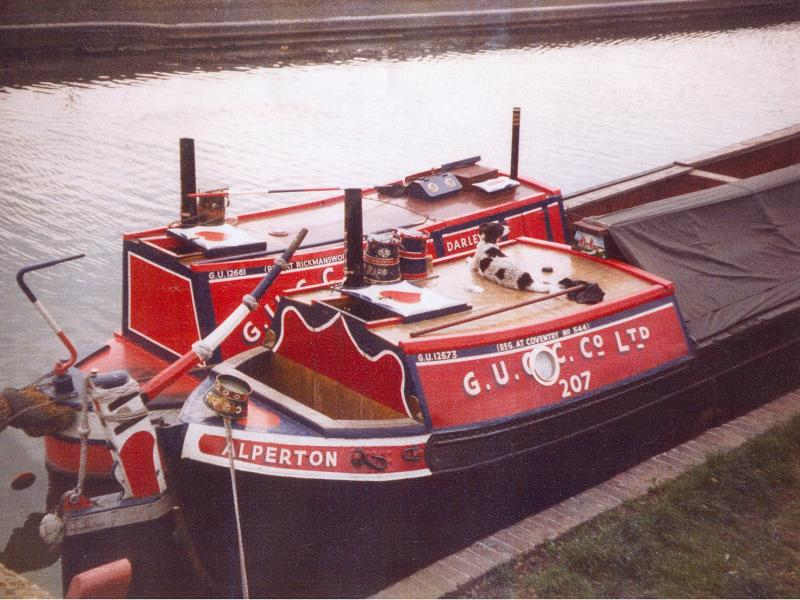 ALPERTON (foreground) - with motor DARLEY. Stern cabin and tiller  from starboard side.