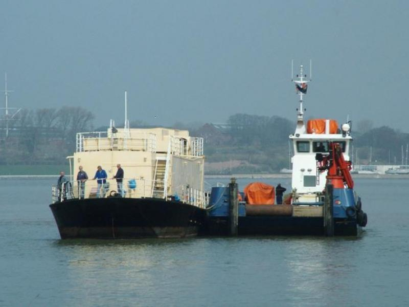 LBK6 bow view with tug alongside