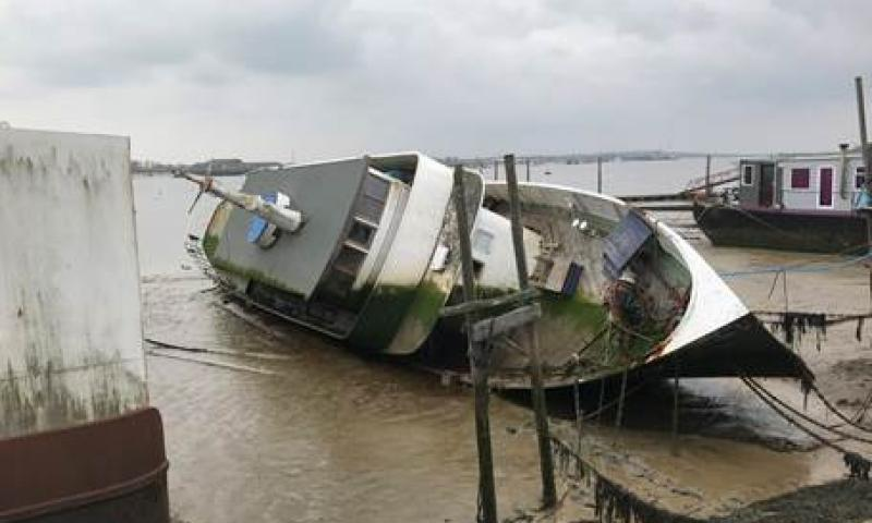 Llys-Helig capsized on moorings April 2018 pending refloat and restoration