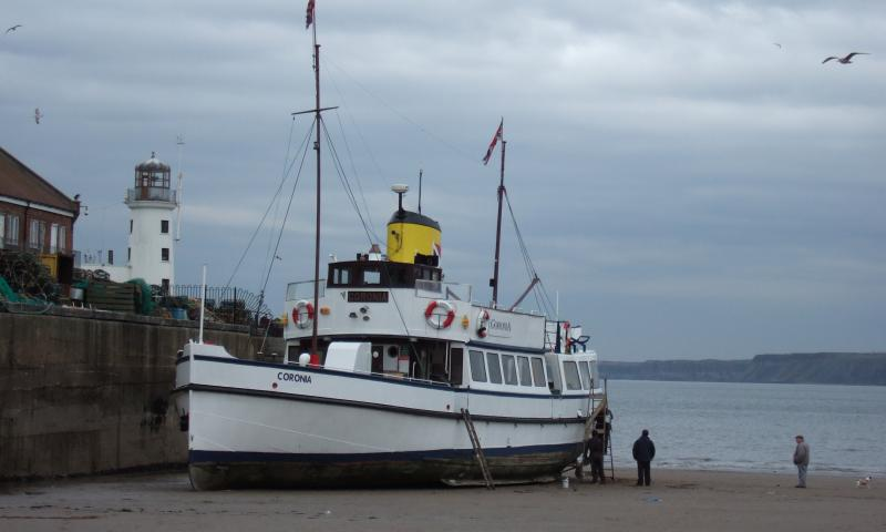 Coronia - beached in Scarborough, being painted 2008