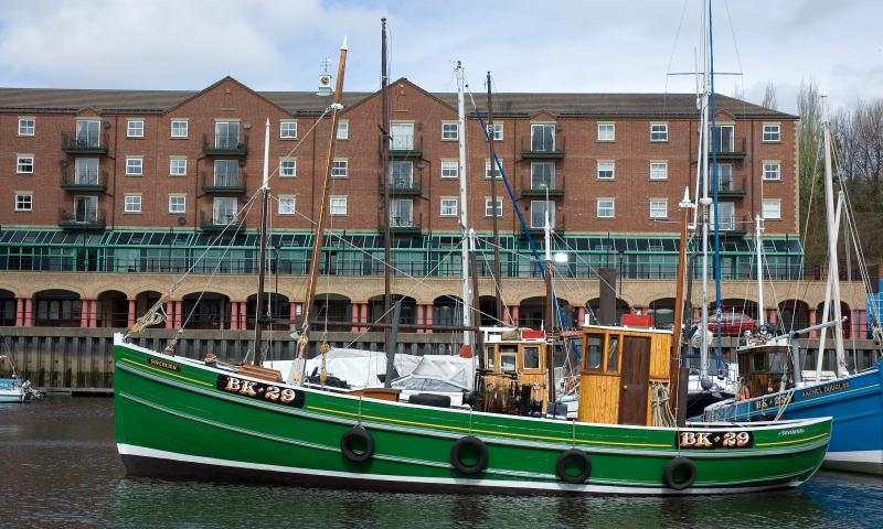 Sovereign - in St Peters Marina, having undergone extensive restoration.  Port side view.