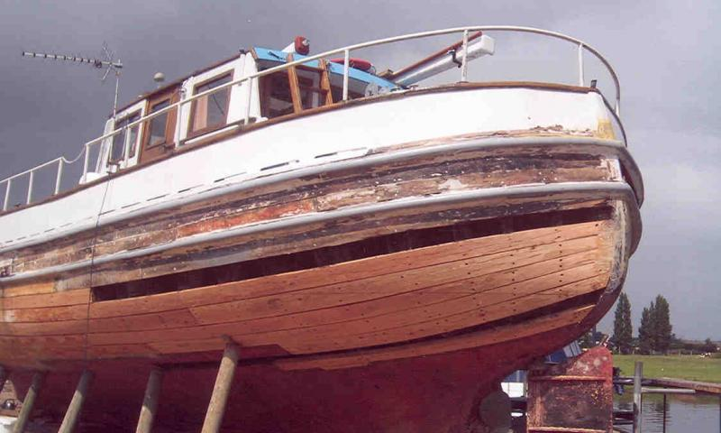 Jean Adair in boatyard undergoing timber repair work to hull