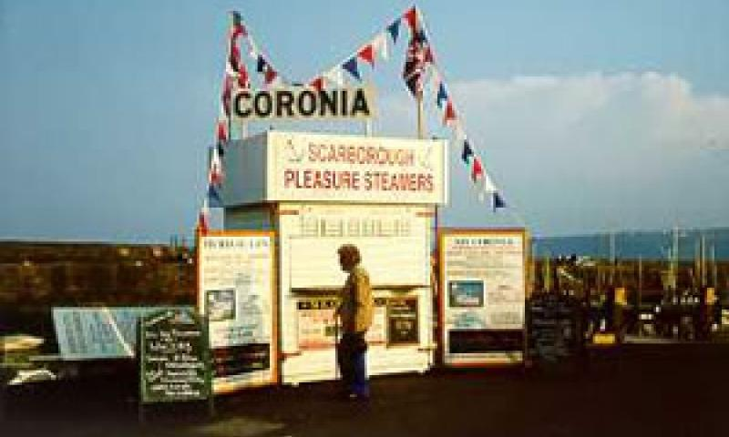 CORONIA - promotion/booking stand on Scarborough harbour wall in May 2000.