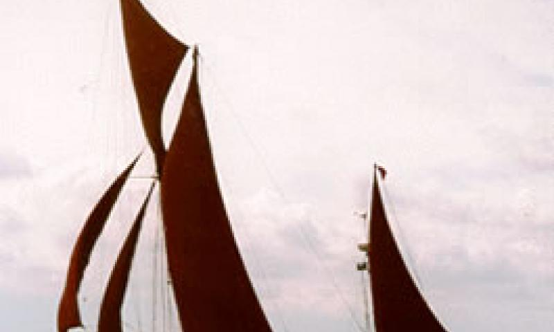 THISTLE - under sail racing in 1997.  Port side.
