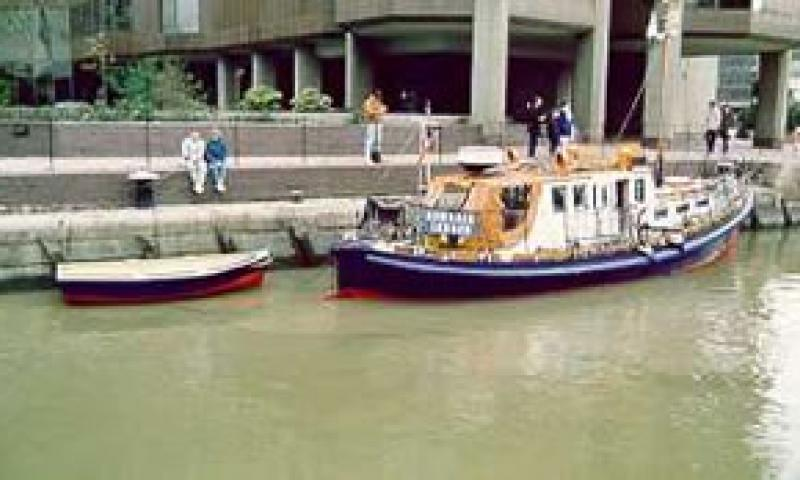 DOWAGER - with tender in St Katherines Dock early 1990s. Starboard quarter.