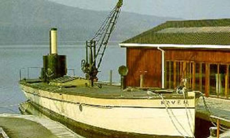 RAVEN moored alongside the quay at the Windermere Steamboat Museum, starboard side showing along deck with crane prominent.