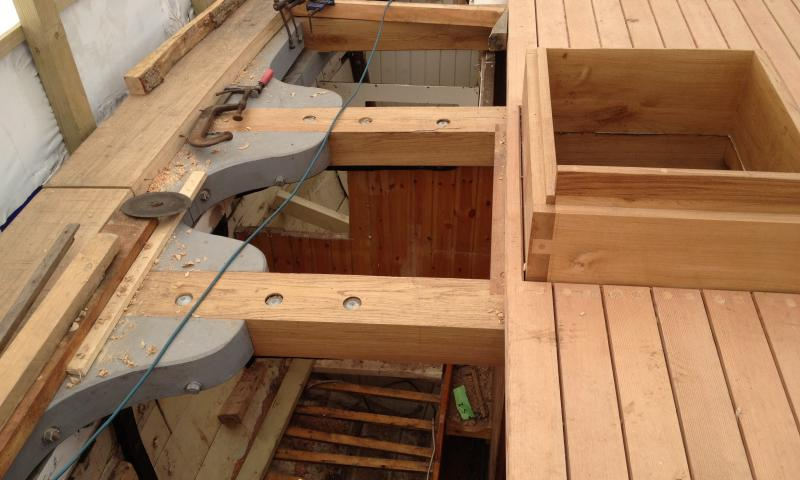 Leader - new deck beams with lodging knees (in grey), a section of the covering board (far left), new forward hatch coaming & a section of new decking