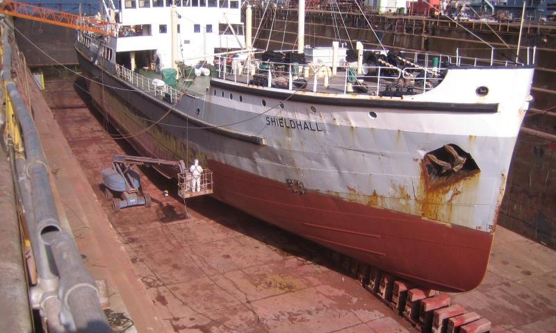 Shieldhall - shows the anti-fouling being applied and is a general view into the dock