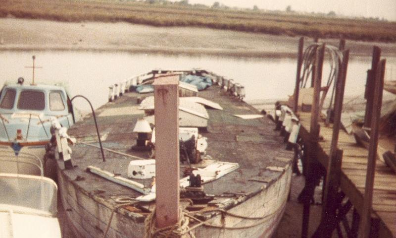 Comus of Wivenhoe without her rig, waiting for restoration